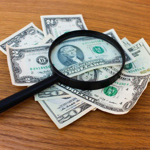 magnifying glass money on table SQUARE 300x300 - magnifying-glass-money-on-table-SQUARE